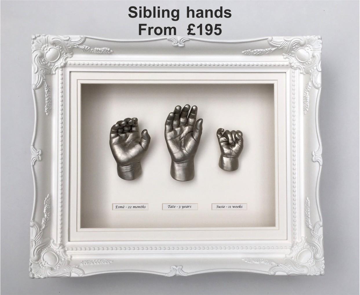 Sibling-hands-framed